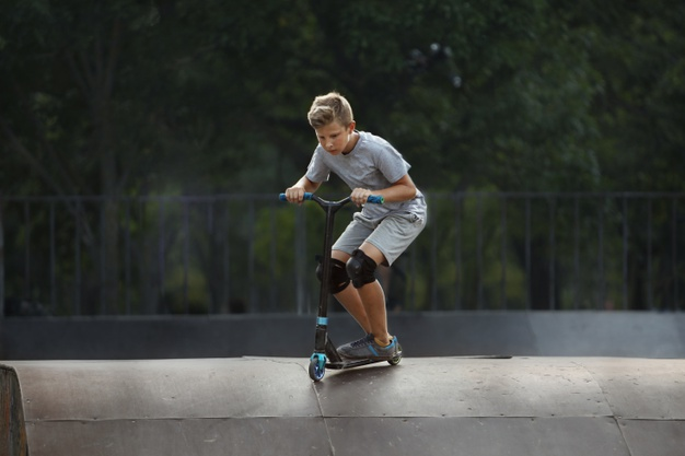 boy-with-scooter-is-going-airborne-at-a-skate-park_320561-132.jpg